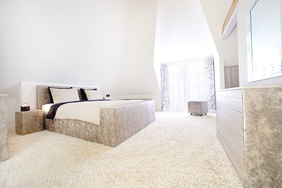 luxe zolder slaapkamer